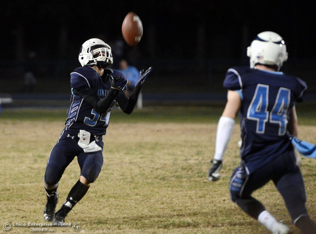 . Pleasant Valley High\'s #34 Cale Crawford catches a punt return against Shasta High in the fourth quarter of their football game at PVHS Asgard Yard Friday, October 18, 2013 in Chico, Calif.  (Jason Halley/Chico Enterprise-Record)