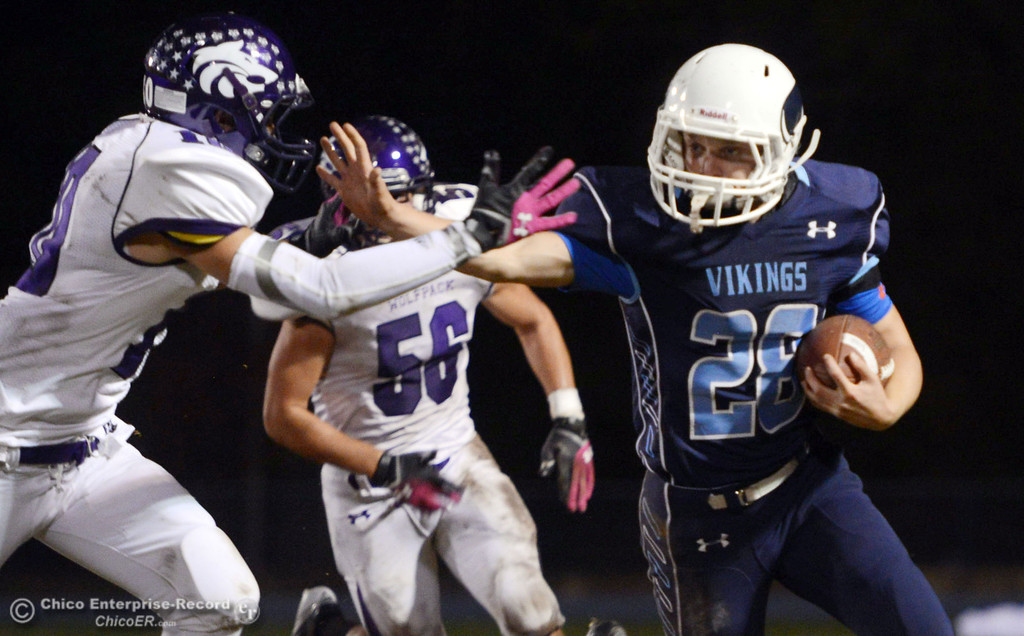 . Pleasant Valley High\'s #28 Dylan Batie (right) rushes against Shasta High\'s #10 Noah Ferguson (left) in the second quarter of their football game at PVHS Asgard Yard Friday, October 18, 2013 in Chico, Calif.  (Jason Halley/Chico Enterprise-Record)
