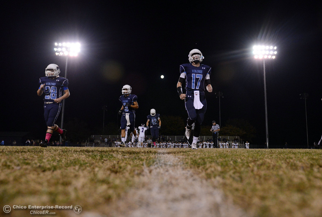 . Pleasant Valley High\'s #28 Dylan Batie, #3 Brandon Romero, #42 Chad Olsen and #17 Troy Owens (left to right) take the field against Shasta High in the first quarter of their football game at PVHS Asgard Yard Friday, October 18, 2013 in Chico, Calif.  (Jason Halley/Chico Enterprise-Record)