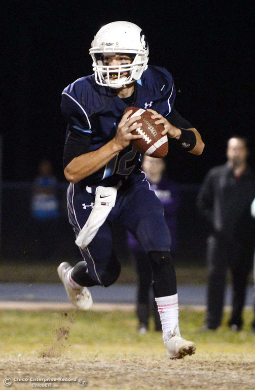 . Pleasant Valley High\'s #12 Trent Darms scrambles against Shasta High in the second quarter of their football game at PVHS Asgard Yard Friday, October 18, 2013 in Chico, Calif.  (Jason Halley/Chico Enterprise-Record)