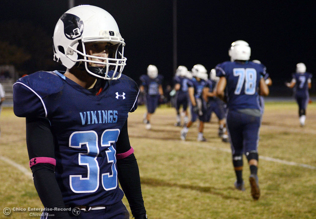 . Pleasant Valley High\'s #33 Taylor Wright looks on against Shasta High in the second quarter of their football game at PVHS Asgard Yard Friday, October 18, 2013 in Chico, Calif.  (Jason Halley/Chico Enterprise-Record)
