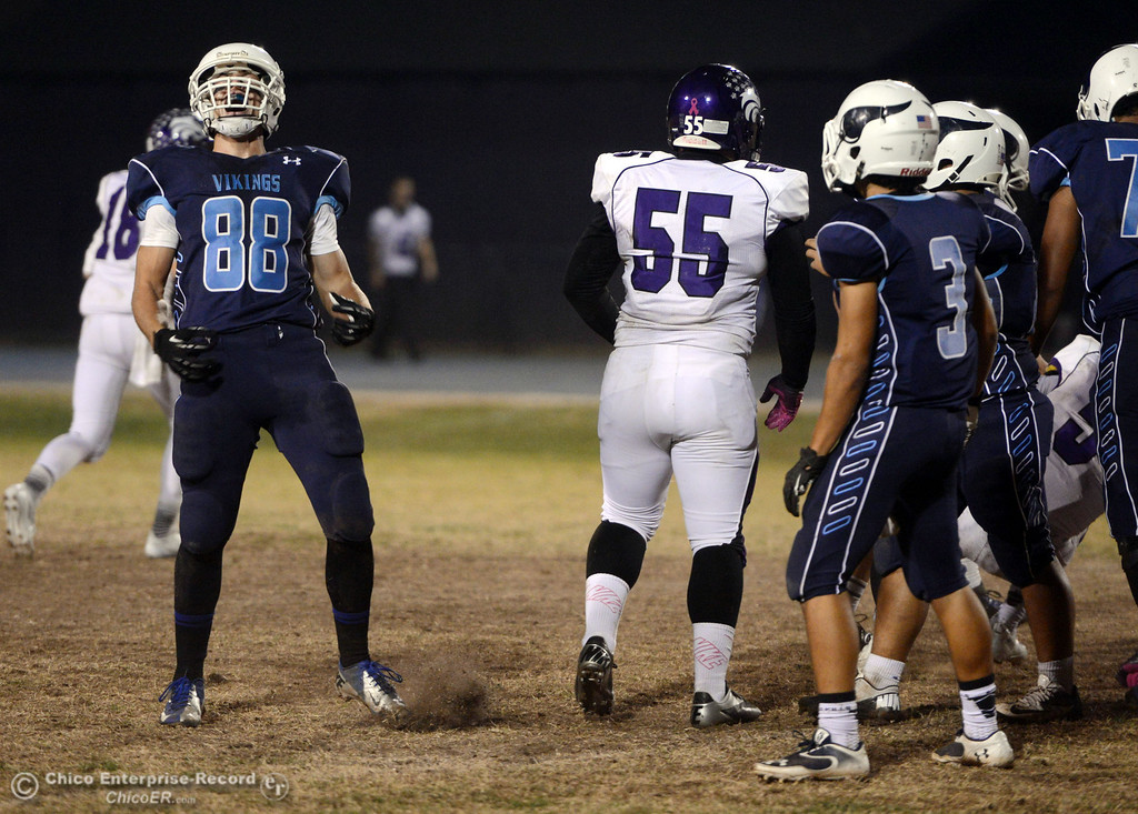. Pleasant Valley High\'s #88 Zack Suttles (left) reacts to making a tackle against Shasta High in the second quarter of their football game at PVHS Asgard Yard Friday, October 18, 2013 in Chico, Calif.  (Jason Halley/Chico Enterprise-Record)