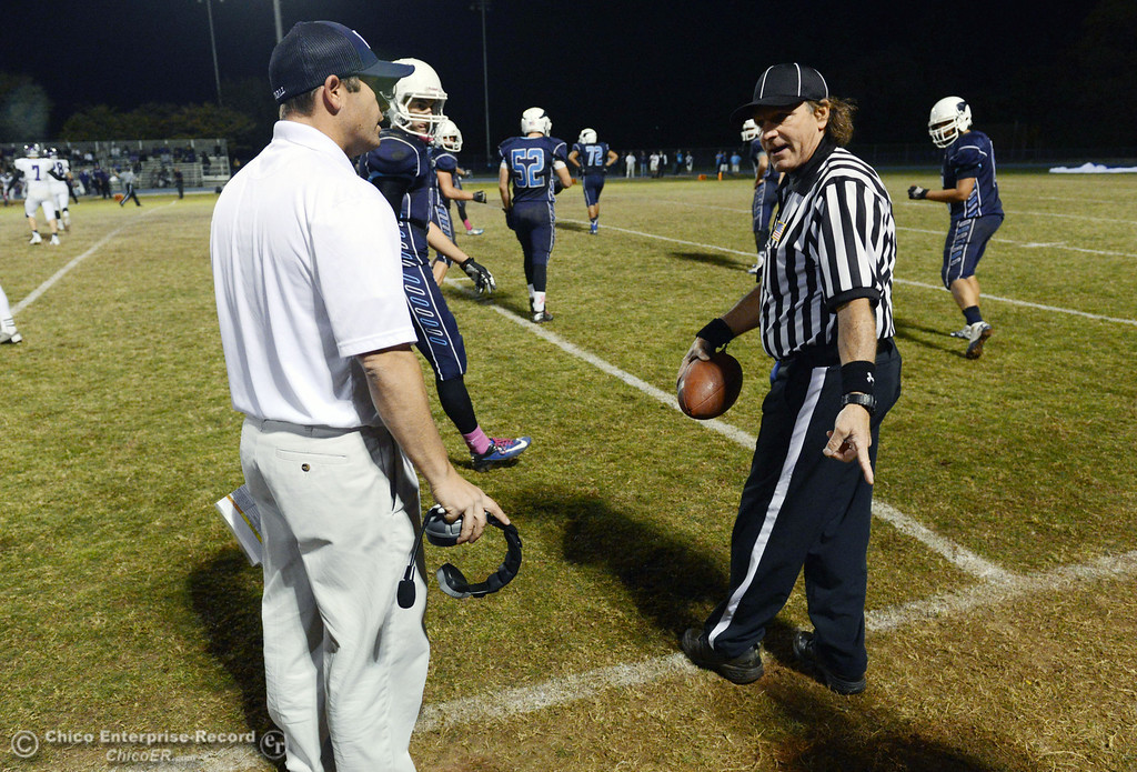 . Pleasant Valley High coach Mark Cooley argues a call to the ref about a late hit that wasn\'t called against Shasta High in the second quarter of their football game at PVHS Asgard Yard Friday, October 18, 2013 in Chico, Calif.  (Jason Halley/Chico Enterprise-Record)