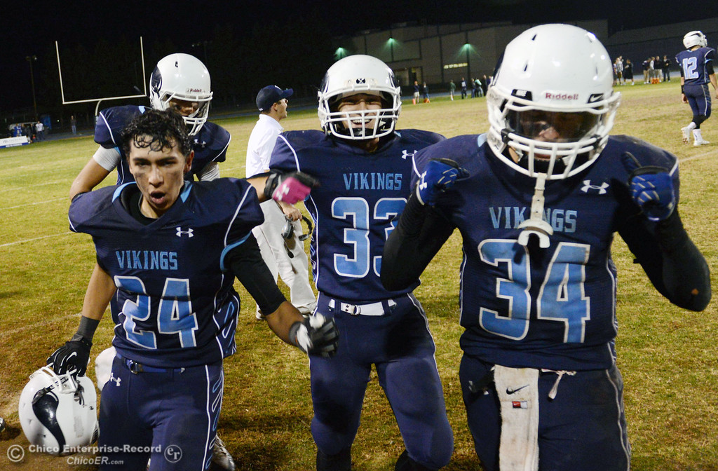 . Pleasant Valley High\'s #24  Jack Soza, #33 Taylor Wright, and #34 Cale Crawford (left to right) celebrate their win against Shasta High in the fourth quarter of their football game at PVHS Asgard Yard Friday, October 18, 2013 in Chico, Calif.  (Jason Halley/Chico Enterprise-Record)