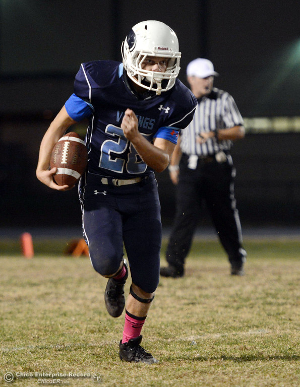 . Pleasant Valley High\'s #28 Dylan Batie rushes against Shasta High in the first quarter of their football game at PVHS Asgard Yard Friday, October 18, 2013 in Chico, Calif.  (Jason Halley/Chico Enterprise-Record)