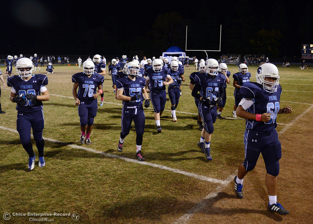 . Pleasant Valley High takes the field against Shasta High before the first quarter of their football game at PVHS Asgard Yard Friday, October 18, 2013 in Chico, Calif.  (Jason Halley/Chico Enterprise-Record)