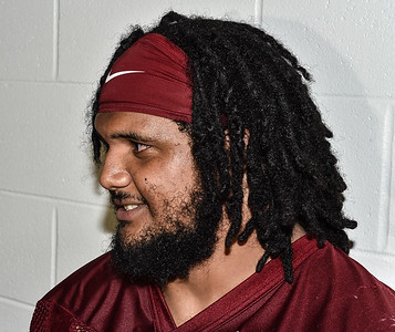 Sebastian Tretola meets the press after the first Fall  Razorback Football practice on Thursday, August 6, 2015 at the Fred W. Smith Football Center in Fayetteville, Arkansas.   Photos by Alan Jamison.