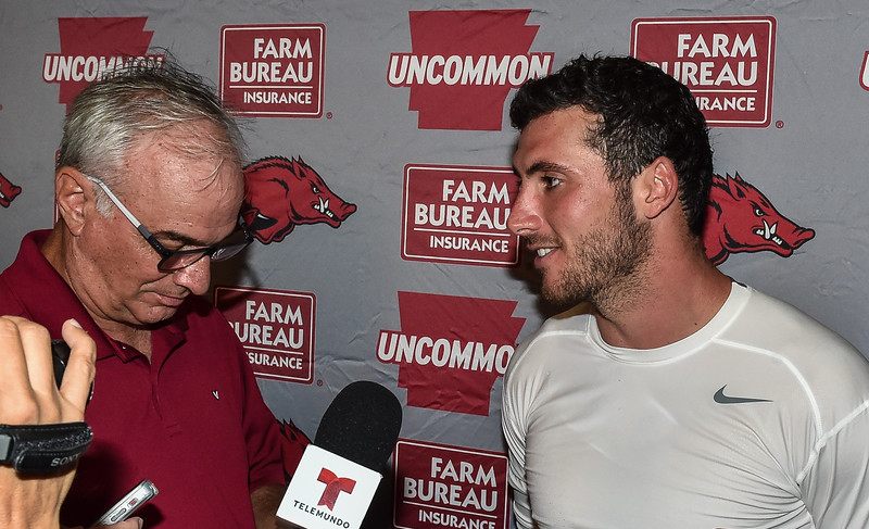 Brandon Allen meets the press after the first Fall  Razorback Football practice on Thursday, August 6, 2015 at the Fred W. Smith Football Center in Fayetteville, Arkansas.   Photos by Alan Jamison.
