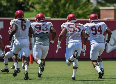 Defensive linemen JaMichael Winston (6), DeMarcus Hodge (93),  Jeremiah Ledbetter (55), and Taiwan Johnson (94) at Razorback Football practice on Saturday, August 8, 2015 at the Fred W. Smith Football Center in Fayetteville, Arkansas.   (Alan Jamison, Nate Allen Sports Service).