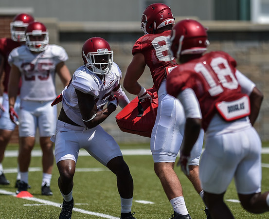 Defensive back Davyon (Sleepy) McKinney (13) and tight end Howie Stettmeier (86) at Razorback Football practice on Saturday, August 8, 2015 at the Fred W. Smith Football Center in Fayetteville, Arkansas.   (Alan Jamison, Nate Allen Sports Service).