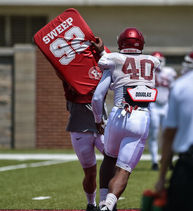 Defensive end Jamario Bell (40) at Razorback Football practice on Saturday, August 8, 2015 at the Fred W. Smith Football Center in Fayetteville, Arkansas.   (Alan Jamison, Nate Allen Sports Service).
