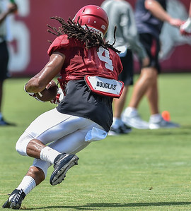 Wide receiver Keon Hatcher (4) at Razorback Football practice on Saturday, August 8, 2015 at the Fred W. Smith Football Center in Fayetteville, Arkansas.   (Alan Jamison, Nate Allen Sports Service).