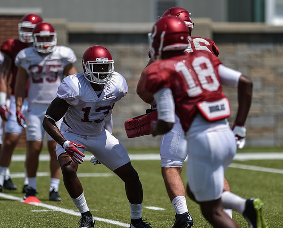 Defensive back Davyon (Sleepy) McKinney (13) and wide receiver Cameron Colbert (18) at Razorback Football practice on Saturday, August 8, 2015 at the Fred W. Smith Football Center in Fayetteville, Arkansas.   (Alan Jamison, Nate Allen Sports Service).