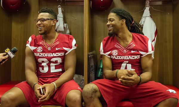 Running back Jonathan Williams (32) and wide receiver Keon Hatcher (4) during Razorback Media Day on Sunday, August 9, 2015 at the Fred W. Smith Football Center in Fayetteville, Arkansas.   (Alan Jamison, Nate Allen Sports Service).