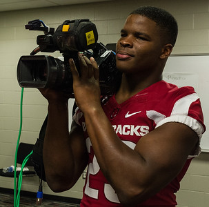 Dre Greenlaw assists the media at the Razorback Media Day on Sunday, August 9, 2015 at the Fred W. Smith Football Center in Fayetteville, Arkansas.   (Alan Jamison, Nate Allen Sports Service).