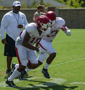 Sleepy McKinney (13) and Ryan Pulley (10) during the Razorback Football practice on Tuesday, August 11, 2015 at the Fred W. Smith Football Center in Fayetteville, Arkansas.   (Alan Jamison, Nate Allen Sports Service).