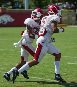Kevin Richardson (30) and Henre' Toliver (5) during the Razorback Football practice on Tuesday, August 11, 2015 at the Fred W. Smith Football Center in Fayetteville, Arkansas.   (Alan Jamison, Nate Allen Sports Service).