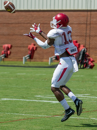 Sleepy McKinney (13) during the Razorback Football practice on Tuesday, August 11, 2015 at the Fred W. Smith Football Center in Fayetteville, Arkansas.   (Alan Jamison, Nate Allen Sports Service).