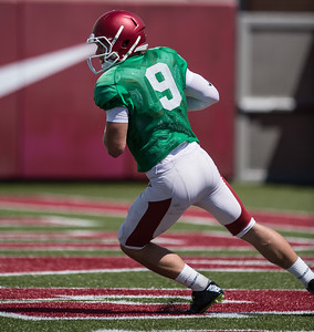 Rafe Peavey (9) seems to have great vision during the Razorback Football practice on Tuesday, August 11, 2015 at the Fred W. Smith Football Center in Fayetteville, Arkansas.   (Alan Jamison, Nate Allen Sports Service).