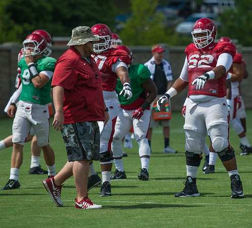 Johnny Gibson (62) and Will Gragg (11) prepare for a drill at the Razorback Football practice on Tuesday, August 11, 2015 at the Fred W. Smith Football Center in Fayetteville, Arkansas.   (Alan Jamison, Nate Allen Sports Service).