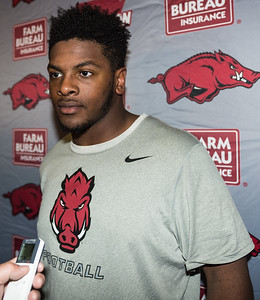 Josh Harris meets with media after the Razorback Football practice on Tuesday, August 11, 2015 at the Fred W. Smith Football Center in Fayetteville, Arkansas.   (Alan Jamison, Nate Allen Sports Service).