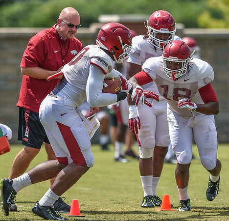 Jamario Bell and Derrick Graham compete during Razorback Football practice on Thursday, August 13, 2015 at the Fred W. Smith Football Center in Fayetteville, Arkansas.   (Alan Jamison, Nate Allen Sports Service).