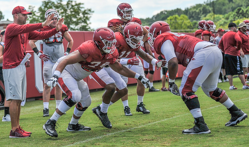 Johnny Gibson goes against Colton Jackson and Will Gragg durin gthe Razorback Football practice on Thursday, August 13, 2015 at the Fred W. Smith Football Center in Fayetteville, Arkansas.   (Alan Jamison, Nate Allen Sports Service).