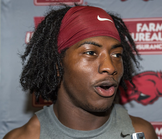 Damon Mitchell meets with media after the Razorback Football practice on Thursday, August 13, 2015 at the Fred W. Smith Football Center in Fayetteville, Arkansas.   (Alan Jamison, Nate Allen Sports Service).