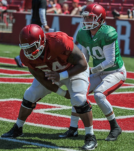 Brandon Allen takes the snap from Reeve Koehler at the Razorback Football practice on Saturday, August 15, 2015 at Reynolds Razorback Stadium in Fayetteville, Arkansas.   (Alan Jamison, Nate Allen Sports Service).