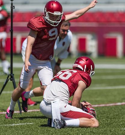 Matt Emrich (56) holds for Cole Hedlund (9) on a field goal attempt at the Razorback Football practice on Saturday, August 15, 2015 at Reynolds Razorback Stadium in Fayetteville, Arkansas.   (Alan Jamison, Nate Allen Sports Service).