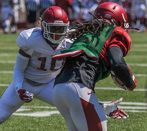 Ryan Pulley takes on Keon Hatcher at the Razorback Football practice on Saturday, August 15, 2015 at Reynolds Razorback Stadium in Fayetteville, Arkansas.   (Alan Jamison, Nate Allen Sports Service).