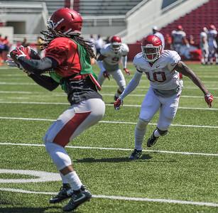 Ryan Pulley takes on Keon Hatcher at the Razorback Football practice on Saturday, August 15, 2015 at Reynolds Razorback Stadium in Fayetteville, Arkansas.   (Alan Jamison, Nate Allen Sports Service).