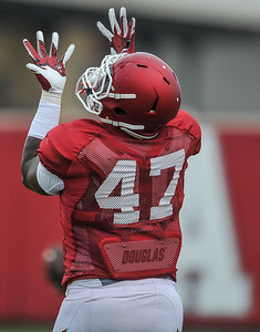Anthony Brown goes up for a catch at the Razorback football practice on Tuesday, August 18, 2015 at the Fred W. Smith Football Center in Fayetteville, Arkansas.   (Alan Jamison, Nate Allen Sports Service).