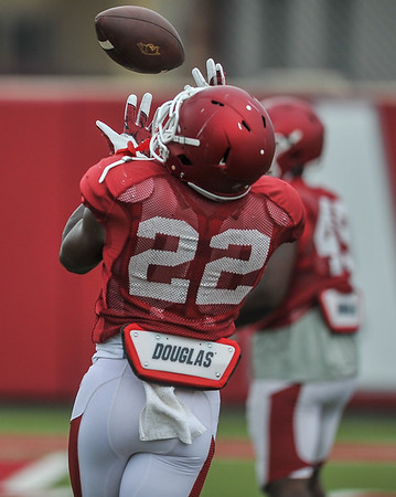 Rawleigh Williams goes up for a catch at the Razorback football practice on Tuesday, August 18, 2015 at the Fred W. Smith Football Center in Fayetteville, Arkansas.   (Alan Jamison, Nate Allen Sports Service).