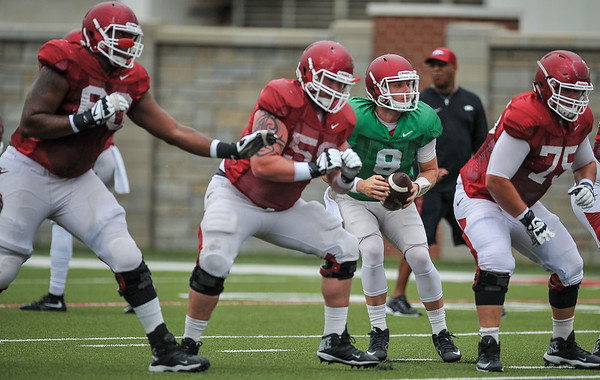 Austin Allen looks downfield at the Razorback football practice on Tuesday, August 18, 2015 at the Fred W. Smith Football Center in Fayetteville, Arkansas.   (Alan Jamison, Nate Allen Sports Service).