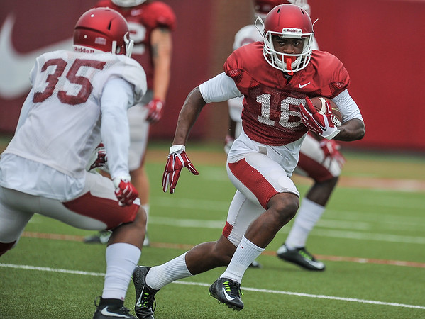 Cameron Colbert eludes Cameron Colbert at the Razorback football practice on Tuesday, August 18, 2015 at the Fred W. Smith Football Center in Fayetteville, Arkansas.   (Alan Jamison, Nate Allen Sports Service).