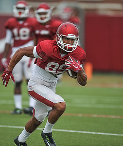 Jovante Siglar runs after a catch at the Razorback football practice on Tuesday, August 18, 2015 at the Fred W. Smith Football Center in Fayetteville, Arkansas.   (Alan Jamison, Nate Allen Sports Service).