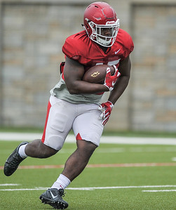 Tyler Colquitt runs with the ball at the Razorback football practice on Tuesday, August 18, 2015 at the Fred W. Smith Football Center in Fayetteville, Arkansas.   (Alan Jamison, Nate Allen Sports Service).