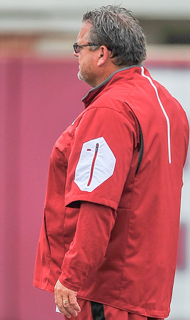 Coach Sam Pittman observes the Razorback football practice on Tuesday, August 18, 2015 at the Fred W. Smith Football Center in Fayetteville, Arkansas.   (Alan Jamison, Nate Allen Sports Service).