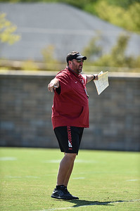 Head Coach Bret Bielema instructs the team during Razorback football practice on Thursday, August 20, 2015 at the Fred W. Smith Football Center in Fayetteville, Arkansas.   (Alan Jamison, Nate Allen Sports Service).