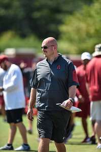 Coach Rory Segrest observes the Razorback football practice on Thursday, August 20, 2015 at the Fred W. Smith Football Center in Fayetteville, Arkansas.   (Alan Jamison, Nate Allen Sports Service).