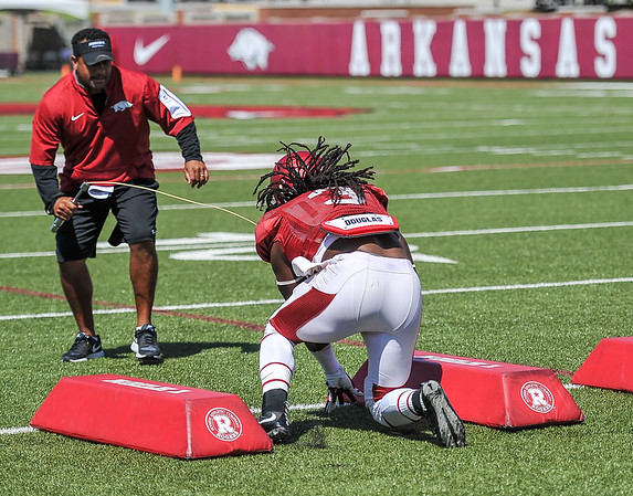 Alex Collins holds on to the ball at the Razorback football practice on Thursday, August 20, 2015 at the Fred W. Smith Football Center in Fayetteville, Arkansas.   (Alan Jamison, Nate Allen Sports Service).