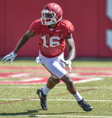 La'Michael Pettway makes a cut for the ball at the Razorback football practice on Thursday, August 20, 2015 at the Fred W. Smith Football Center in Fayetteville, Arkansas.   (Alan Jamison, Nate Allen Sports Service).