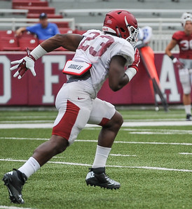 Dre Greenlaw participates in a special team drill during the Razorback football practice on Saturday, August 22, 2015 at Reynolds Razorback Stadium in Fayetteville, Arkansas.   (Alan Jamison, Nate Allen Sports Service).
