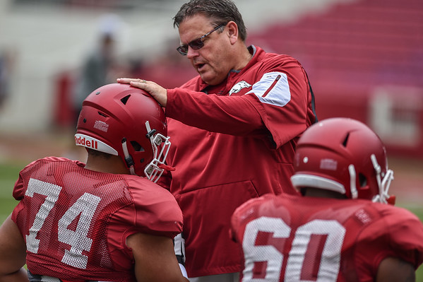 Coach Sam Pittman with Colton Jackson (74) and Brian Wallace (60) at the Razorback football practice on Saturday, August 22, 2015 at Reynolds Razorback Stadium in Fayetteville, Arkansas.   (Alan Jamison, Nate Allen Sports Service).