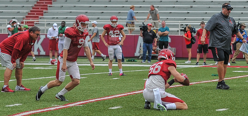 Matt Emrich holds for a field goal attempt by Cole Hedlund during the Razorback football practice on Saturday, August 22, 2015 at Reynolds Razorback Stadium in Fayetteville, Arkansas.   (Alan Jamison, Nate Allen Sports Service).