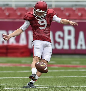 Cole Hedlund kicks off during the Razorback football practice on Saturday, August 22, 2015 at Reynolds Razorback Stadium in Fayetteville, Arkansas.   (Alan Jamison, Nate Allen Sports Service).