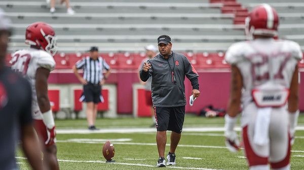 Coach Jemal Singleton instructs the team during the Razorback football practice on Saturday, August 22, 2015 at Reynolds Razorback Stadium in Fayetteville, Arkansas.   (Alan Jamison, Nate Allen Sports Service).