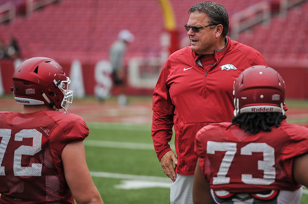 Coach Sam Pittman talks to Frank Ragnow (72) and Sebastion Tretola (73) at the Razorback football practice on Saturday, August 22, 2015 at Reynolds Razorback Stadium in Fayetteville, Arkansas.   (Alan Jamison, Nate Allen Sports Service).