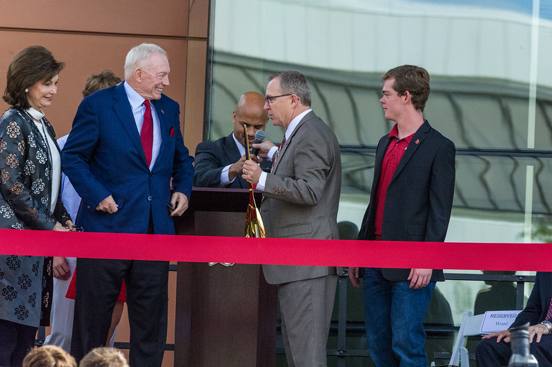 Vice Chancellor and Director of Athletics Jeff Long with the golden scissors at the dedication of the Jerry and Gene Jones Family Student-Athlete Success Center on  the campus of the University of Arkansas in Fayetteville, Arkansas.   (Alan Jamison, Nate Allen Sports Service)